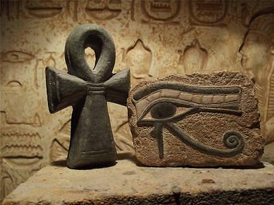 Egyptian Art - Eye of Horus and Ankh amulet. Ancient Egypt carving / Sculpture