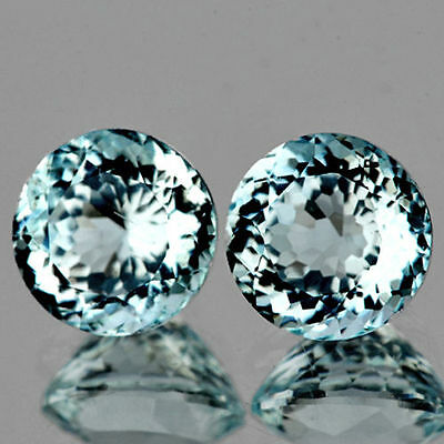 A PAIR OF 5mm ROUND-FACET STRONG AQUA-BLUE LAB AQUAMARINE GEMSTONES