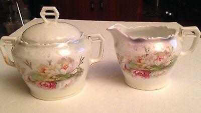 Set of Creamer & Sugar Bowl with lid marked Germany water lillies lily pads