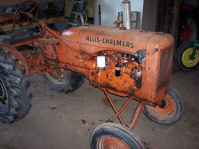 Allis Chalmers B  tractor has foot brakes runs great