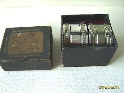 PAIR OF EARLY 20th CENTURY BOXED SILVER PLATED NAPKIN RINGS