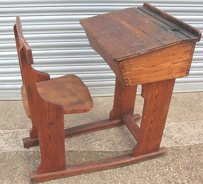 Old wooden antique solid pine vintage church or school desk and seat on ski's