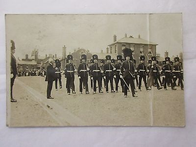 old rp postcard trooping the colour?  saluting base   card is creased (unposted)