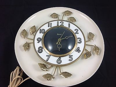 Vintage UNITED Retro Mid Century Electric Wall Clock Leaves Model 45  works