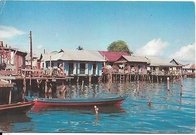 SINGAPORE, Houses on stilts on an island opposite the Singapore Harbour postcard