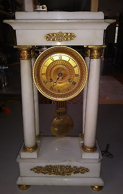 19th century French Empire White marble and Gilt bronze Portico clock