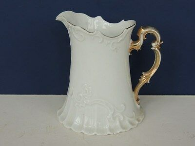 Antique Victorian white embossed porcelain pitcher ornate gold handle