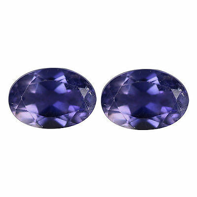 A PAIR OF 6x4mm OVAL-FACET PURPLE/BLUE NATURAL AFRICAN IOLITE GEMSTONES