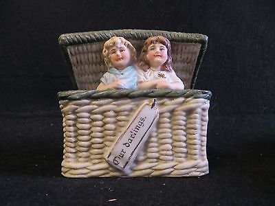 """Germany Heubach bisque girls in a basket """"Our darlings"""""""
