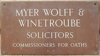 Old bronze enamel English plaque sign Jewish solicitors attorneys office Hull