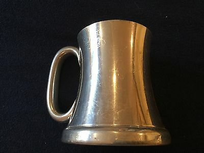 A Small Silver Plated Tankard -