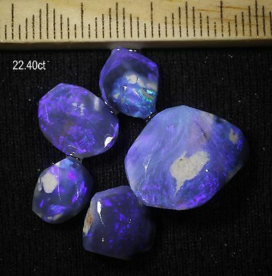 PARCEL OF BLACK OPAL PIECES WITH BEAUTIFUL BLUE COLOURS! 22.40ct
