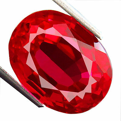 A PAIR OF 7x5mm OVAL-FACET TOP-RED LAB RUBY GEMSTONES