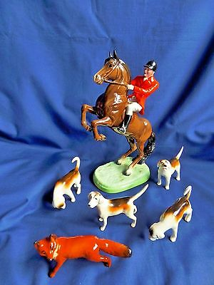 Beswick Huntsman No. 868 with four Hounds and a Fox Group