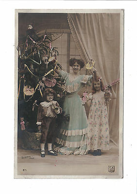 Vintage French Christmas Postcard.Children with decorated tree and toys