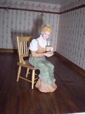 Dolls house figure 1/12th scale poly/resin Vict. lady sitting with cup