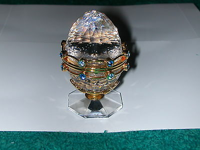 Swarovski Crystal SECRETS EGG With Garland Stand And Contents Retired