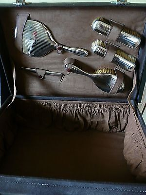 1930s Leather Vanity case with Hallmarked Silver vanity mirror brushes etc