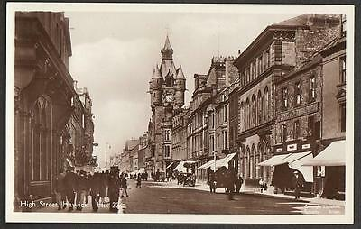 REAL PHOTO POSTCARD HIGH STREET HAWICK ROXBURGHSHIRE R DEANS SHOP FRONT c1918
