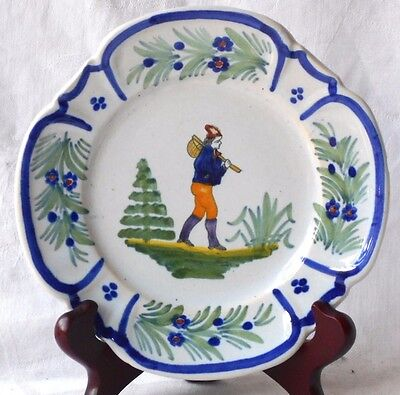French Faience Plate With A Breton Man Carrying A Bag