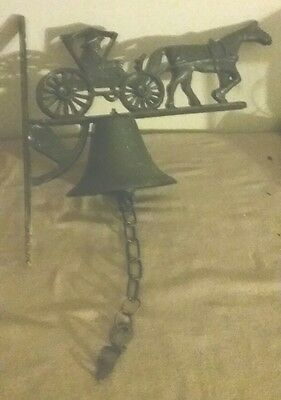 Vintage heavy  cast iron horse and buggy dinner bell  pre owned
