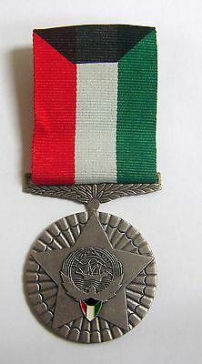 Officers award 4th Class Kuwait Liberation Medal.