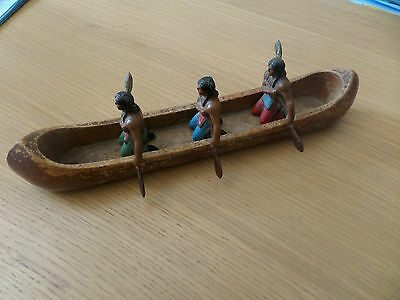 Native American Indian toy soldiers in canoe
