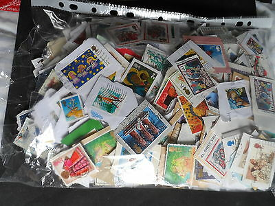 approx  2000 christmas stamps on & off paper G.B approx 375grms lot 8