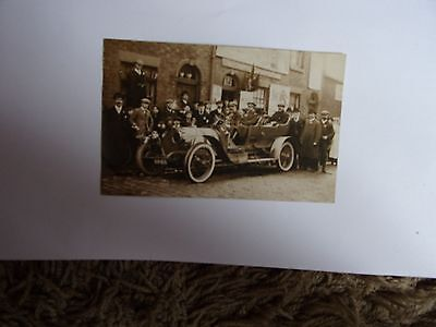 vintage  political postcard showing a large open air car and a group of men