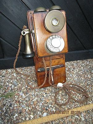 Vintage wooden Ericsson wall mounted telephone with rotary dial and bell box
