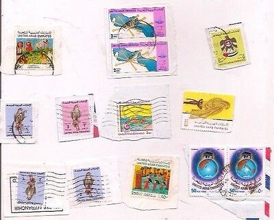 14 UNITED ARAB EMIRATES stamps on paper.