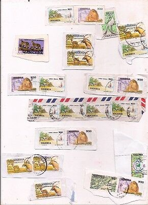 24 NIGERIA stamps on paper.