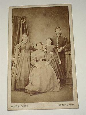 PORTRAIT OF A SOLDIER IN UNIFORM WITH HIS FAMILY, VICTORIAN CDV Cox, Northampton