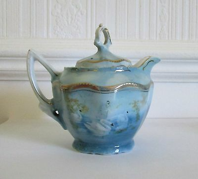 Antique porcelain covered creamer, swans & lake decoration with golden accent