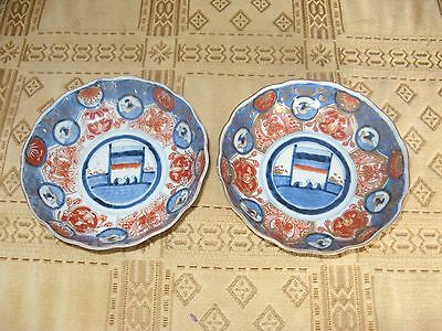 2 large early 19th century japanese imari bowls.signed on base.hand painted