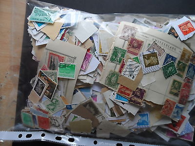lot 2   300 grms approx G.B & world mix stamps on & off paper pot luck
