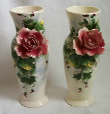 antique hand thrown  pair of italian faience  vases with applied flowers