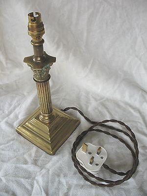 Old antique brass Corinthian pillar table lamp on stepped base