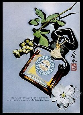 1969 Guerlain Mitsouko perfume bottle floating in water photo vintage print ad