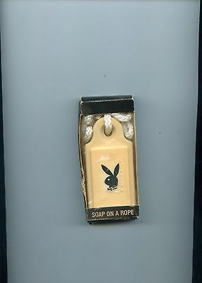 Vintage Playboy soap on a rope in original package, shows wear to edge of box