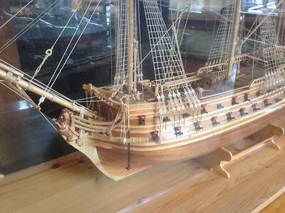Fantastic large wooden war ship model in a wood and glass case