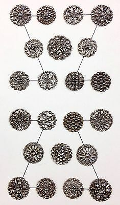 Lovely card of 22 medium cut steel buttons. All different, excellent condition!