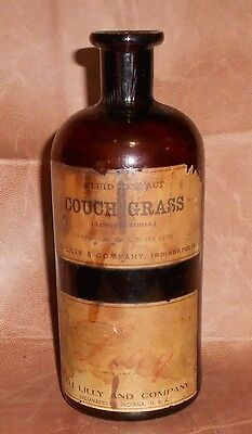 c1915 Antique Amber Pharmacy Bottle Eli Lilly  Couch Grass