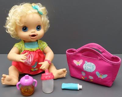 2010 Baby Alive Real Surprises Interactive Doll with Accessories Blonde Blue Eye