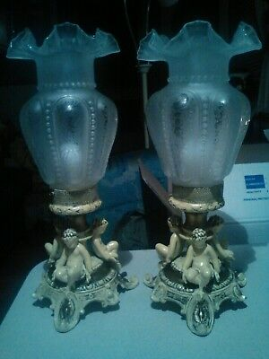 Pair of Victorian cast iron cherub mantle Luster's lamps