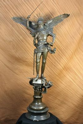 Statue of Archangel Michael in the abbey of Mont Saint Normandy, France Bronze