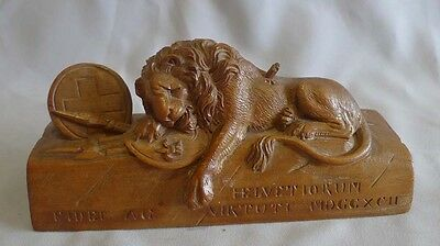 The Lion of Lucerne carved in Walnut.
