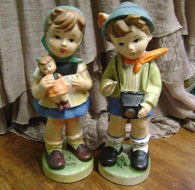 "Vintage  Lot Of 2-  Boy/camera, Girl/doll Japan-  9 3/4 "" In Height  Figurines"