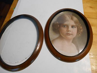 matching pair of oval antique vintage wood picture frames