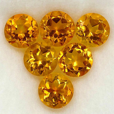 A PAIR OF 4mm ROUND-FACET NATURAL BRAZILIAN BRANDY CITRINE GEMSTONES